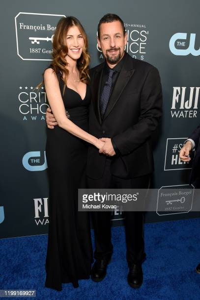 Jackie Sandler and Adam Sandler attends the 25th annual Critics' Choice Awards at Barker Hangar on January 12 2020 in Santa Monica California