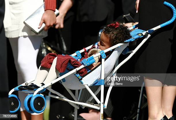 Jackie, Sean Taylor's daughter, 18 months, sleeps in her stroller as she arrives for her father's funeral services at Pharmed Arena on December 3,...