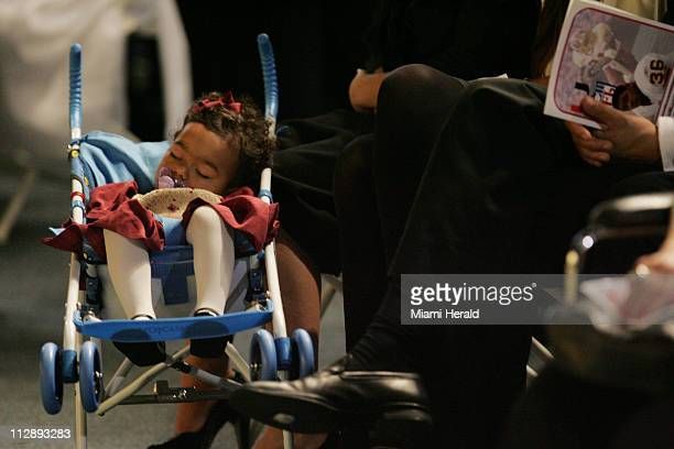 Jackie Sean Taylor's young daughter sleeps on her stroller minutes before the start of funeral services for Sean Taylor at the Pharmed Arena in the...