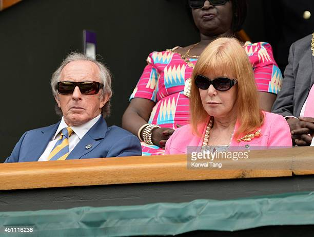 Jackie Stewart and Helen Stewart attend the Andy Murray v David Goffin match on centre court during day one of the Wimbledon Championships at...