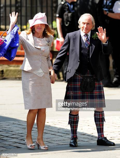 Jackie Stewart and wife Helen arriving for the wedding of Zara Phillips and Mike Tindall