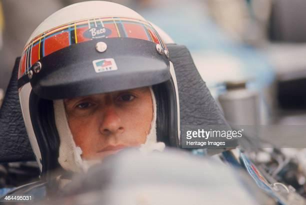 Jackie Stewart at the wheel of a racing car Scottish motor racing driver Jackie Stewart began his Formula 1 career in 1965 winning the Italian Grand...