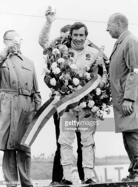 Jackie Stewart celebrating victory at The Dutch Grand Prix Zandvoort 1968 Scottish motor racing driver Jackie Stewart began his Formula 1 career in...