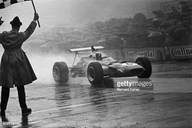 Jackie Stewart, Matra-Ford MS10, Grand Prix of Germany, Nurburgring, August 4, 1968. In rain and fog, Jackie Stewart taking the checkered flag and...
