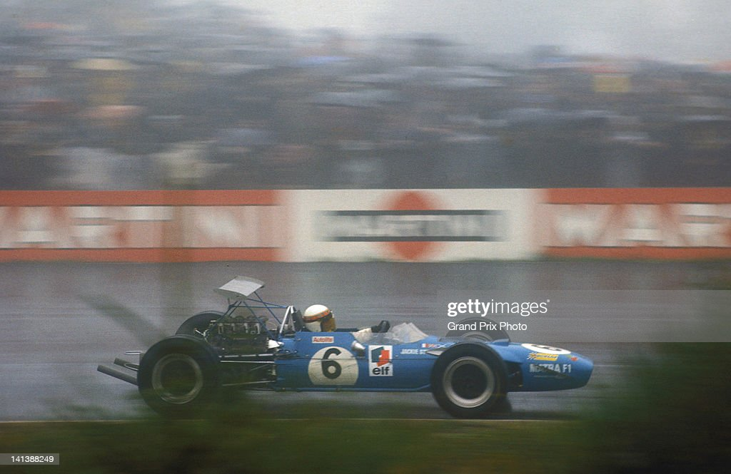 Jackie Stewart of Great Britain drives the #6 Matra International Matra MS80 Ford Cosworth DFV in the rain during the wet German Grand Prix on 4th August 1968 at the Nurburgring near Nurburg, Germany.