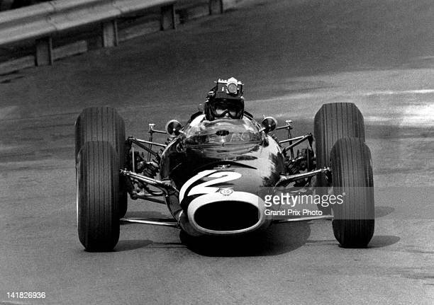 Jackie Stewart of Great Britain drives the Owen Racing Organisation BRM P261 BRM V8 with a Nikon SLR camera attached to his helmet to give a drivers...