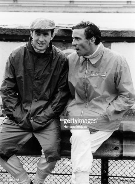 Jackie Stewart on the left and Jim Clark 1967 Chatting at the side of the track at the Italian Grand Prix at Monza Stewart's career lasted until 1973...