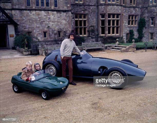 Jackie Stewart posing with a 1957 BRM Beside him his two children sit in a miniature racing car He began his Formula 1 career in 1965 winning the...