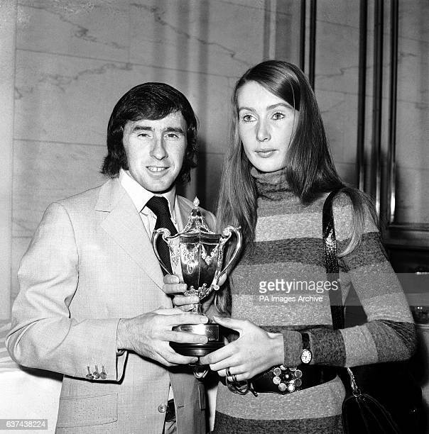 Jackie Stewart presents the Formula One World Drivers' Championship trophy to Jochen Rindt's widow Nina after Rindt was killed during practice for...