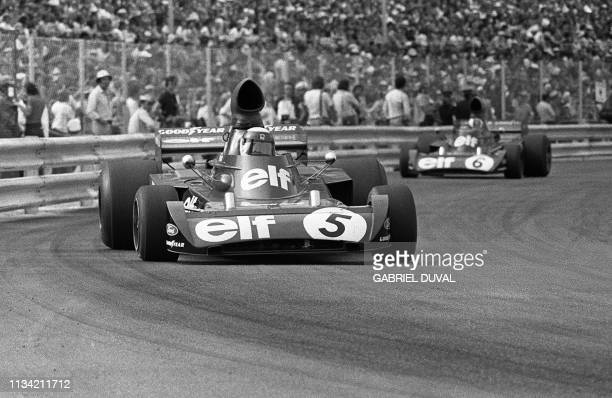Jackie Stewart triple Formula One champion takes a curve 04 June 1973 followed by François Cevert during the MonteCarlo Grand prix Stewart won the...