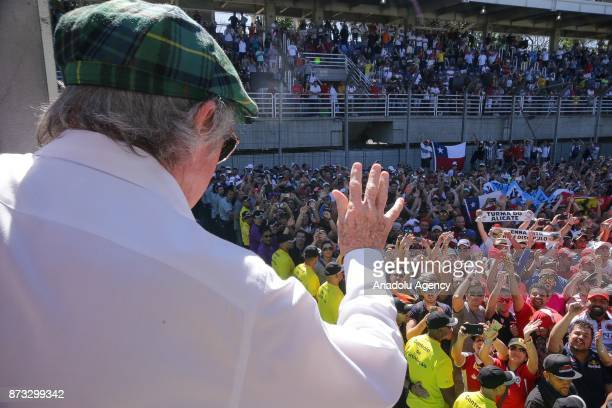 Jackie Stewart waves the crowd as he celebrates the victory in 2017 Formula One Brazil Grand Prix at the Jose Carlos Pace racetrack in Sao Paulo...