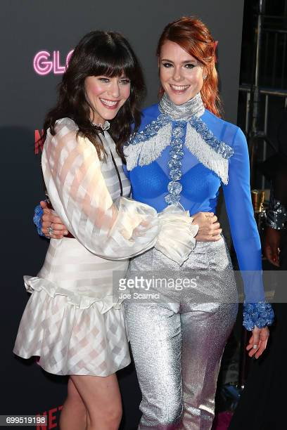 Jackie Tohn and Kate Nash arrive at the premiere Of Netflix's 'GLOW' at The Cinerama Dome on June 21 2017 in Los Angeles California