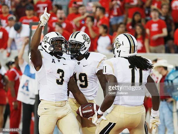 Jackie Williams of the UCF Knights celebrates a 6yard touchdown catch in the first half of the game against the Houston Cougars at TDECU Stadium on...