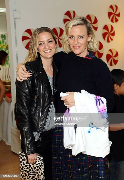 Jackie Winnick and Ali Taekman attends the Third Annual Baby2Baby Holiday Party presented by The Honest Company on December 14 2013 in Los Angeles...