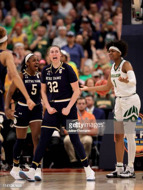 Jackie Young and Jessica Shepard of the Notre Dame Fighting Irish celebrate a basket as NaLyssa Smith of the Baylor Lady Bears reacts during the...