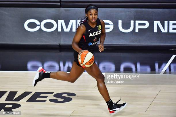 Jackie Young of the Las Vegas Aces dribbles up court during the first half of Game 2 of their Third Round playoffs against the Connecticut Sun at...