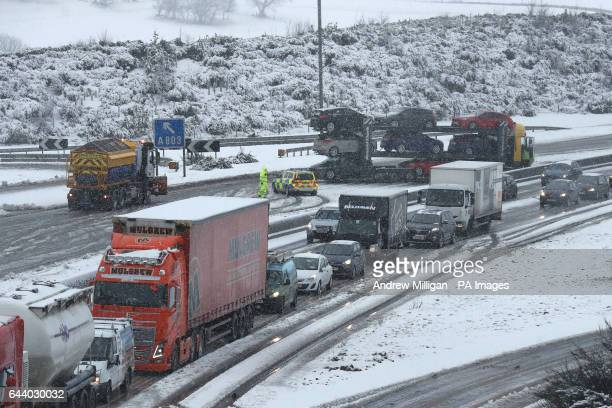 A jackknifed car transporter near Banknock on the M80 near Falkirk during early morning snowfall as flights have been cancelled and commuters were...