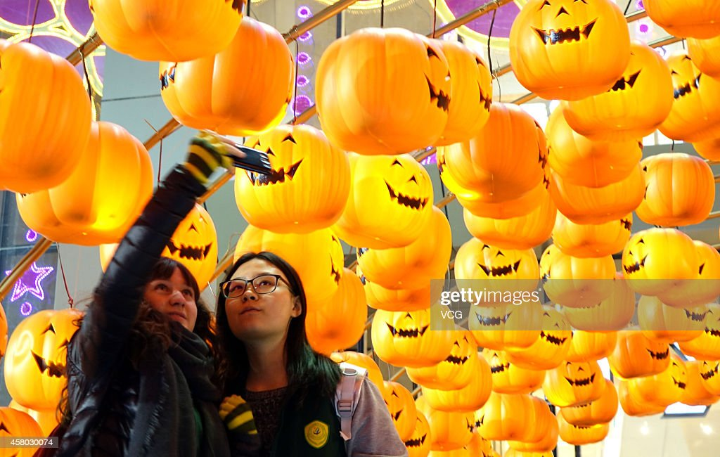 Jack-o-lanterns hang on the front gate of a shooping mall on October 28, 2014 in Zhengzhou, Henan province of China. A shopping mall celebrates the upcoming Halloween with hundreds of Jack-o-lanterns on Tuesday.