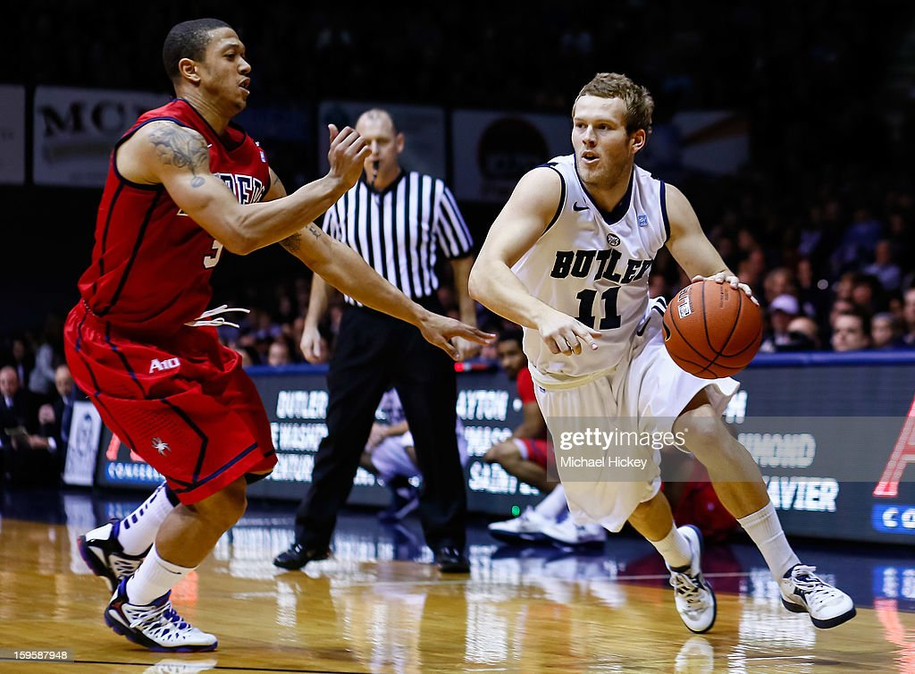 Jackson Aldridge #11 of the Butler Bulldogs dribble the ball against Darien Brothers #3 of the Richmond Spiders at Hinkle Fieldhouse on January 16, 2013 in Indianapolis, Indiana. Butler defeated Richmond 62-47.