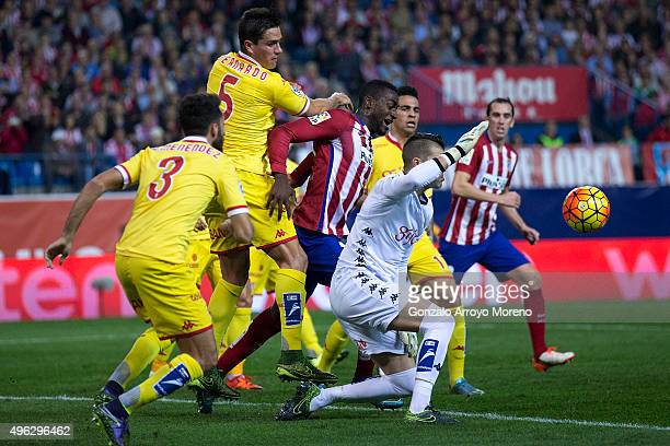Jackson Arley Martinez of Atletico de Madrid competes for the ball with goalkeeper Ivan Cuellar of Real Sporting de Gijon and his teammates Alex...
