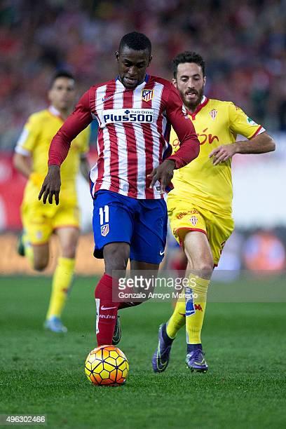 Jackson Arley Martinez of Atletico de Madrid runs for the ball ahead Alex Menendez of Real Sporting de Gijon during the La Liga mathc bewteen Club...