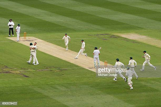 Jackson Bird of Australia celebrates the wicket of MisbahulHaq of Pakistan with Nic Maddinson of Australia who caught him out during day one of the...