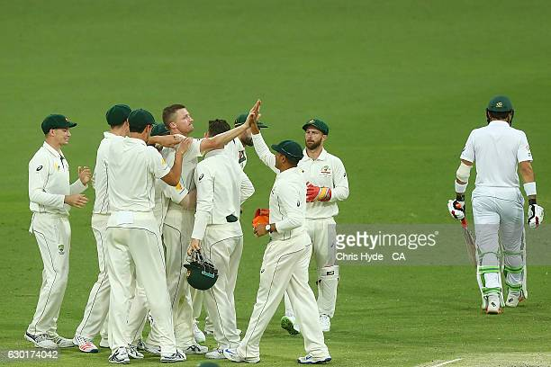 Jackson Bird of Australia celebrates with team mates after dismissing MisbahulHaq of Pakistan during day four of the First Test match between...