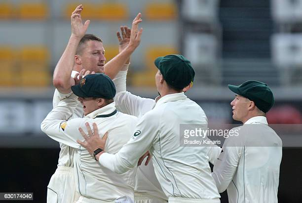 Jackson Bird of Australia celebrates with team mates after taking the wicket of MisbahulHaq of Pakistan during day four of the First Test match...