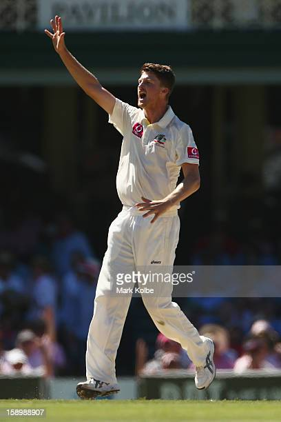 Jackson Bird of Australia sucessfully appeals for the wicket of Dimuth Karunaratne of Sri Lanka during day three of the Third Test match between...