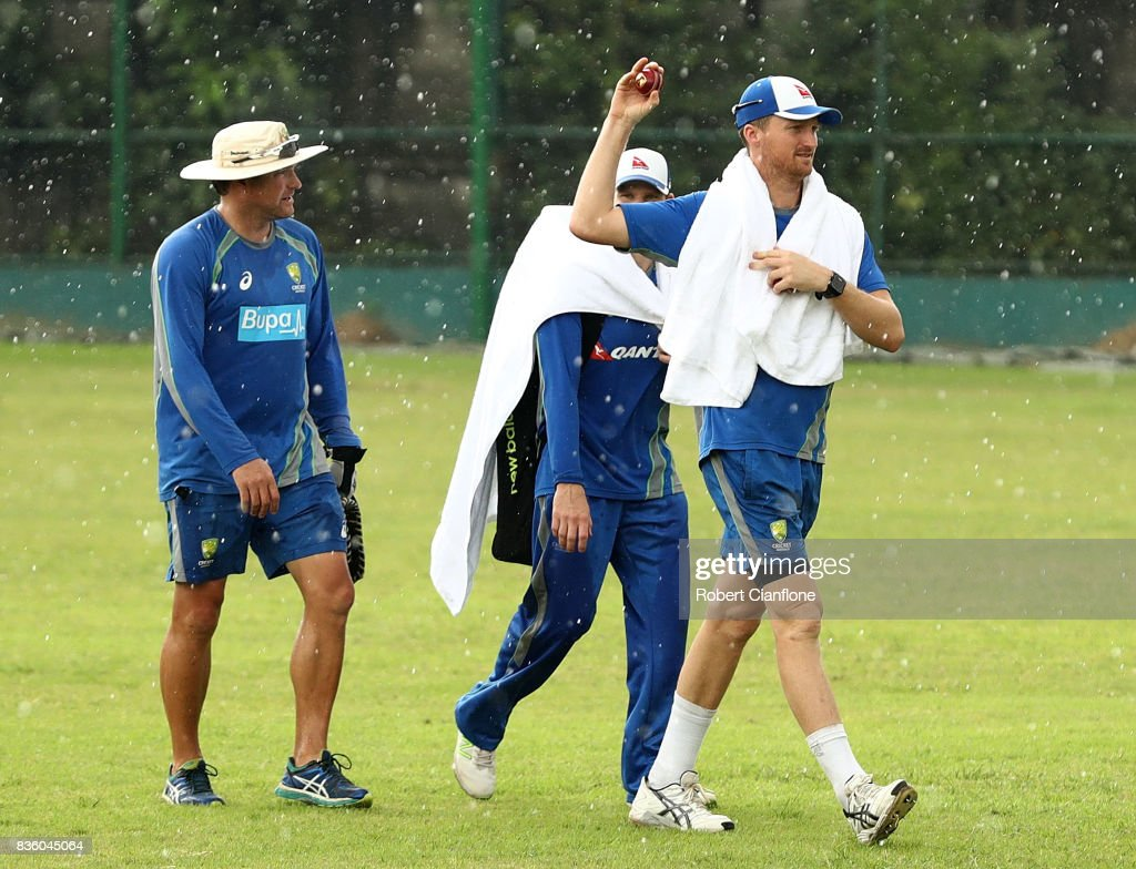 Jackson Bird of Australia walks off the ground as rain falls during an Australian Test team nets session at Sher-E Bangla National Cricket Stadium on August 21, 2017 in Dhaka, Bangladesh.