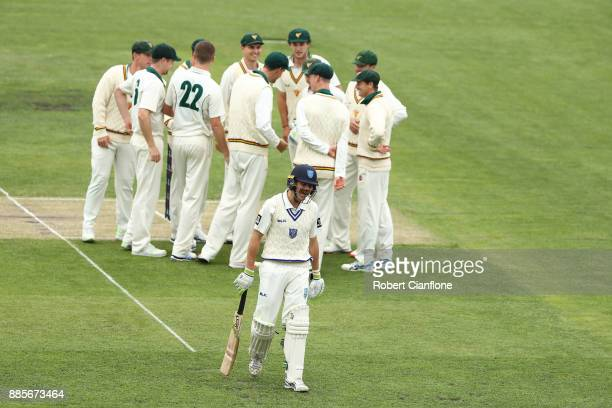 Jackson Bird of Tasmania celebrates taking the wicket of Daniel Hughes of NSW during day three of the Sheffield Shield match between New South Wales...
