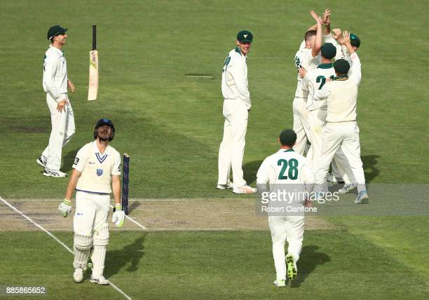 Jackson Bird of Tasmania celebrates taking the wicket of Dniel Hughes of NSW during day three of the Sheffield Shield match between New South Wales...