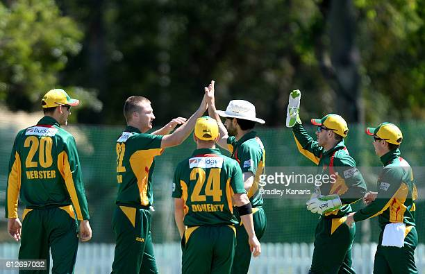 Jackson Bird of Tasmania celebrates with team mates after taking the wicket of Jake Carder during the Matador BBQs One Day Cup match between Tasmania...