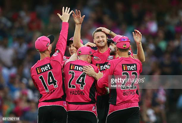 Jackson Bird of the Sixers celebrates with team mates after taking the wicket of Sunil Narine of the Renegades during the Big Bash League match...