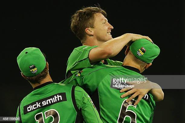 Jackson Bird of the Stars celebrates his dismissal of Jos Buttler of the Renegades with Matthew Wade and Luke Wright during the Big Bash League match...