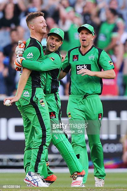 Jackson Bird of the Stars celebrates his wicket of Nic Maddinson of the Sixers with Tom Triffitt during the Big Bash League match between the...