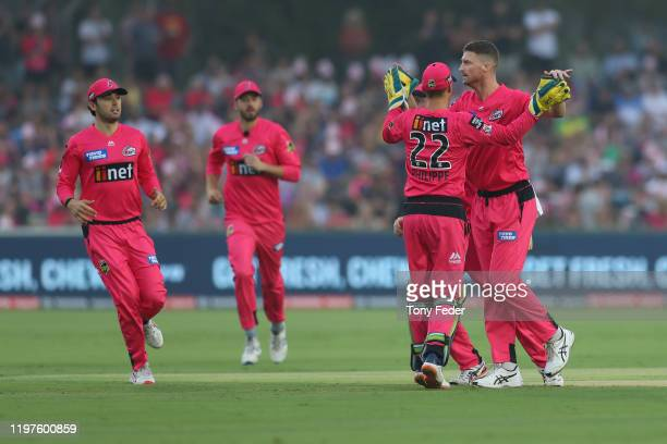 Jackson Bird of the Sydney Sixers celebrates with team mate Josh Philippe during the Big Bash League match between the Sydney Sixers and the Adelaide...