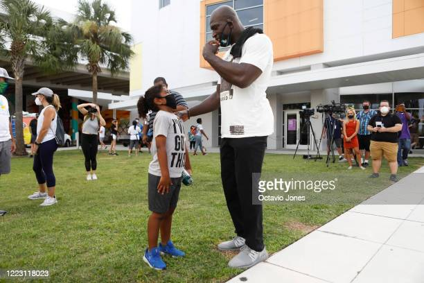 Jackson Brown talks with WWE wrestler Titus O'Neil before the start of the Love Walk at Curtis Hixon Park on June 27 2020 in Tampa Florida Thaddeus...