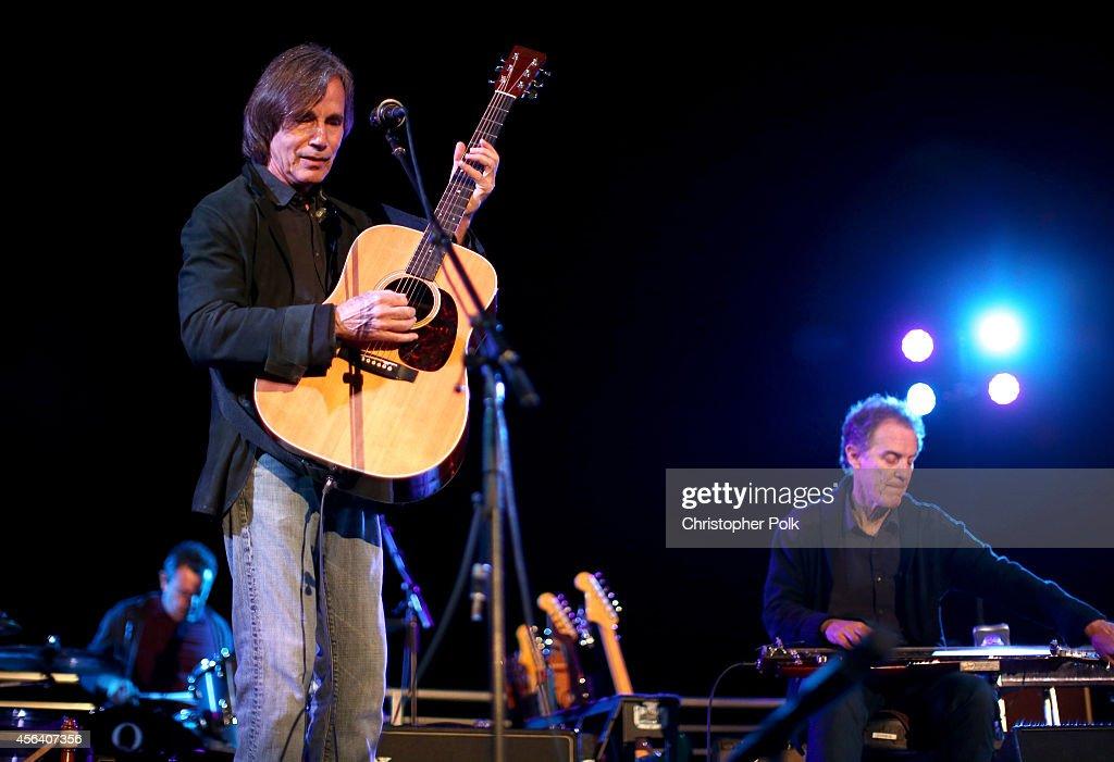 Jackson Browne performs at Rock4EB, Malibu, with Jackson Browne & David Spade sponsored by Suja Juice & Sabra Hummus at Private Residence on September 28, 2014 in Malibu, California.