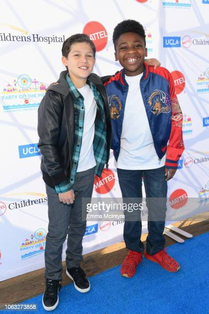 Jackson Dollinger and Christian J Simon attend the UCLA Mattel Children's Hospital's 19th Annual Party on the Pier at Santa Monica Pier on November...
