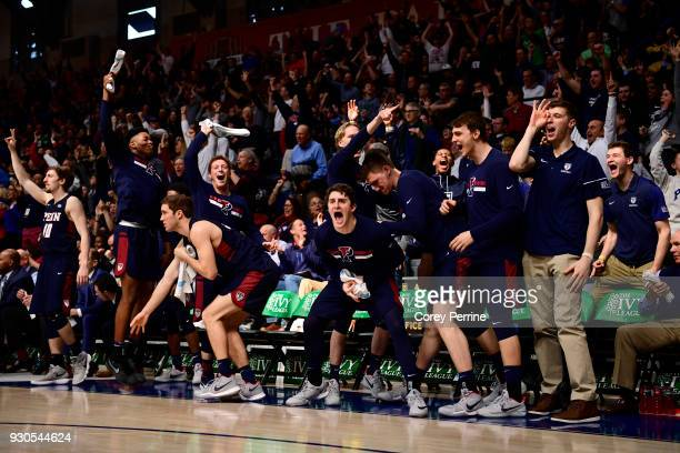 Jackson Donahue and the rest of the of the Pennsylvania Quakers erupt after a three point basket during the second half of the Men's Ivy League...