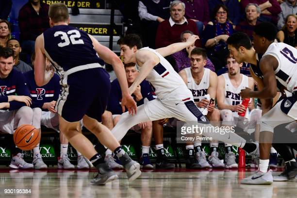 Jackson Donahue of the Pennsylvania Quakers and Blake Reynolds of the Yale Bulldogs track down the ball during the second half of a semifinal round...