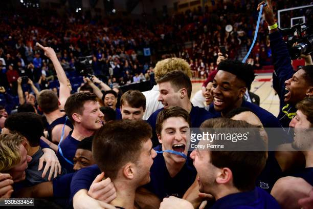Jackson Donahue of the Pennsylvania Quakers celebrates winning the Men's Ivy League Championship Tournament with teammates at The Palestra on March...