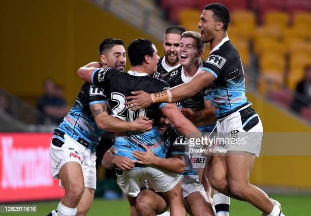 Jackson Ferris of the Sharks is congratulated by team mates after scoring a try during the round 12 NRL match between the Brisbane Broncos and the...