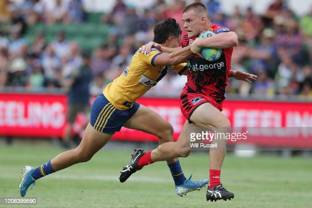 Jackson Ford of the Dragons is tackled by Haze Dunster of the Eels during Day 2 of the 2020 NRL Nines at HBF Stadium on February 15, 2020 in Perth,...