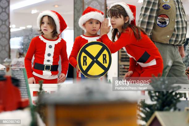 Jackson Garcia center is flanked by his cousins Emma Bennett left and her sister Elizabeth Bennett as they survey a sprawling series of model train...