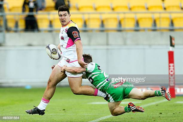 Jackson GardenBachop of Wellington is tackled by Kayne Hammington of Manawatu during the round nine ITM Cup match between Wellington and Manawatu at...