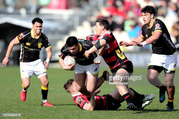Jackson GardenBachop of Wellington is tackled during the round two Mitre 10 Cup match between Canterbury and Wellington at AMI Stadium on August 25...