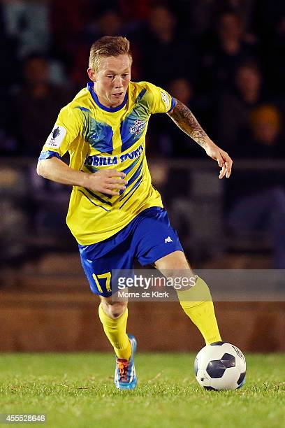 Jackson Hall of Brisbane runs with the ball during the FFA Cup match between Adelaide City and the Brisbane Strikers at the on September 16 2014 in...