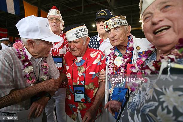 Jackson Harris John Finn Allen Bodenlos and Ernie Mangrum talk after the conclusion of the 65th Anniversary Pearl Harbor Day December 7 2006 in Pearl...